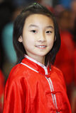 Ritratto cinese della ragazza con i vestiti tradizionali Fotografia Stock