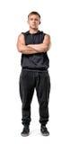 Ritratto completo del corpo del giovane muscoloso bello con le armi piegate isolato su fondo bianco Fotografia Stock Libera da Diritti