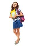 Ragazza teenager con il mucchio dei libri Fotografie Stock