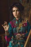 Ritratto d'annata stilizzato della giovane donna fotografia stock