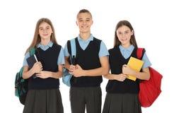Ritratto degli adolescenti in uniforme scolastico fotografie stock libere da diritti