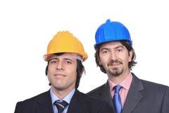 Ritratto degli uomini di affari con gli elmetti protettivi Fotografia Stock