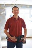 Ritratto dei miglioramenti di Carrying Out Home del costruttore fotografia stock libera da diritti
