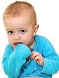 Ritratto del bambino biondo avvizzito che è scaredly lookin Immagini Stock Libere da Diritti