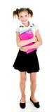 Ritratto del bambino felice sorridente della ragazza della scuola con i libri Fotografia Stock