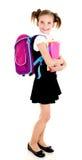 Ritratto del bambino sorridente della ragazza della scuola con lo zaino ed i libri Fotografia Stock