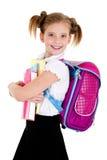 Ritratto del bambino sorridente della ragazza della scuola con lo zaino ed i libri dentro Immagine Stock