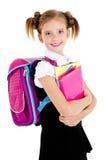 Ritratto del bambino sorridente della ragazza della scuola con lo zaino ed i libri dentro Immagini Stock Libere da Diritti