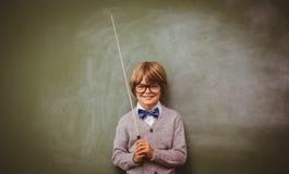 Ritratto del bastone sveglio della tenuta del ragazzino Fotografia Stock Libera da Diritti