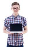 Ritratto del computer portatile bello della tenuta dell'adolescente con il ghiaione in bianco Fotografia Stock Libera da Diritti
