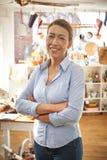 Ritratto del negozio di Standing In Cook della donna di affari Immagine Stock Libera da Diritti