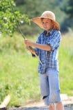 Ritratto del pescatore adolescente con il ramoscello Immagine Stock Libera da Diritti
