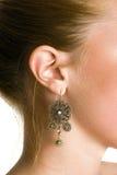 Ritratto del primo piano di un orecchio femminile Immagine Stock