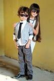 Ritratto del ragazzino e della ragazza alla moda Immagini Stock Libere da Diritti