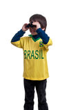 Ritratto del ragazzo con il binocolo sopra fondo bianco Fotografia Stock Libera da Diritti