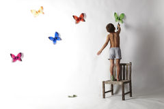 Ritratto del ragazzo con le farfalle Fotografia Stock Libera da Diritti