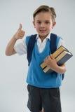 Ritratto del ragazzo di scuola che mostra i pollici su Fotografia Stock Libera da Diritti