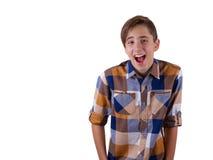 Ritratto del ragazzo teenager attraente che è fotografato in uno studio Isolato su priorità bassa bianca Fotografia Stock