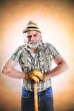 Ritratto dell'agricoltore con il suo piccone Immagini Stock Libere da Diritti