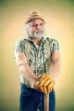 Ritratto dell'agricoltore con il suo piccone Fotografia Stock