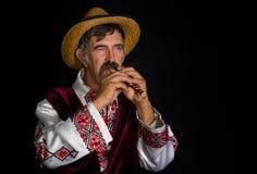 Ritratto dell'agricoltore ucraino con il sopilka Fotografia Stock