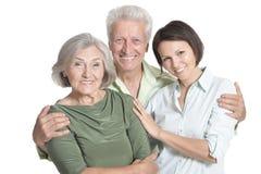 Ritratto dell'genitori senior felici con la figlia, isolato Fotografie Stock