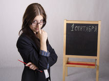 Ritratto dell'insegnante, con i suoi occhiali sul naso e sul bordo nei precedenti Fotografia Stock