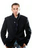Ritratto dell'uomo adulto serio in cappotto nero Fotografia Stock Libera da Diritti