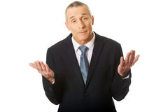 Ritratto dell'uomo d'affari che fa gesto indeciso Fotografia Stock