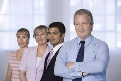 Ritratto dell'uomo d'affari e della sua squadra. immagini stock libere da diritti
