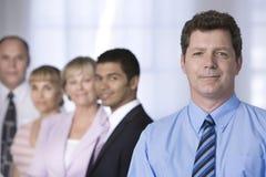 Ritratto dell'uomo d'affari e della sua squadra. fotografia stock