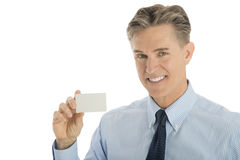 Ritratto dell'uomo d'affari felice Showing Blank Card Fotografie Stock Libere da Diritti