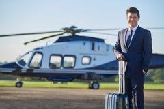 Ritratto dell'uomo d'affari Standing In Front Of Helicopter Immagine Stock Libera da Diritti