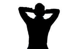 Ritratto dell'uomo della siluetta che allunga riposo Immagini Stock Libere da Diritti
