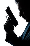 Ritratto dell'uomo della siluetta con la pistola Immagini Stock Libere da Diritti