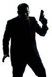 Ritratto dell'uomo della siluetta con la pistola Fotografia Stock Libera da Diritti