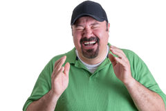 Ritratto dell'uomo estatico che porta camicia verde Immagine Stock Libera da Diritti