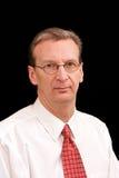Ritratto dell'uomo più anziano di affari in camicia ed in legame sopra Immagine Stock