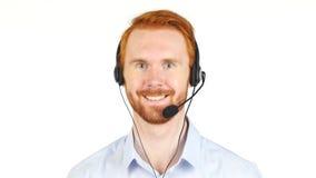 Ritratto dell'uomo sorridente con la cuffia, call center, cliente servive fotografia stock
