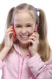 Ritratto della bambina con due Fotografie Stock