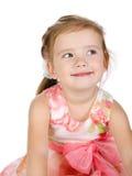 Ritratto della bambina sorridente sveglia in vestito immagine stock