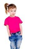 Ritratto della bambina sveglia in jeans Fotografie Stock Libere da Diritti