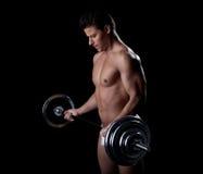 Ritratto della barretta di sollevamento sforzata dell'atleta Fotografie Stock Libere da Diritti