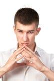 Ritratto della condizione del giovane isolato su bianco Fotografia Stock