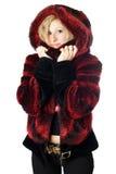 Ritratto della donna bionda sorridente in rivestimento della pelliccia Fotografia Stock