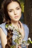 Ritratto della donna con il fiore Fotografia Stock