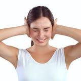 Ritratto della donna con le mani sulle orecchie Fotografie Stock