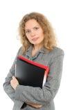 Ritratto della donna di affari con un dispositivo di piegatura fotografia stock