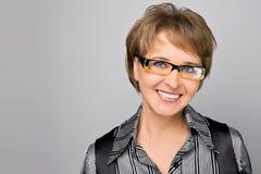 Ritratto della donna di affari in vetri Fotografia Stock Libera da Diritti