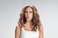 Ritratto della donna disgustata Immagine Stock